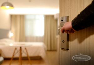 Hand opening the door of the bedroom
