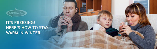 a family in thick blanket while holding a warm cup of drink