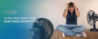 a man with 2 electric fans