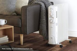 electric heater beside a sofa chair