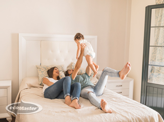 young family playing in their bedroom