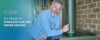 ecoMaster Maurice Beinat next to a stainless steel flue hot water heater