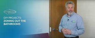 ecoMaster Maurice Beinat in front of their bathroom door