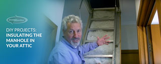 ecoMaster Maurice Beinat pointing out the manhole before the attic stairs